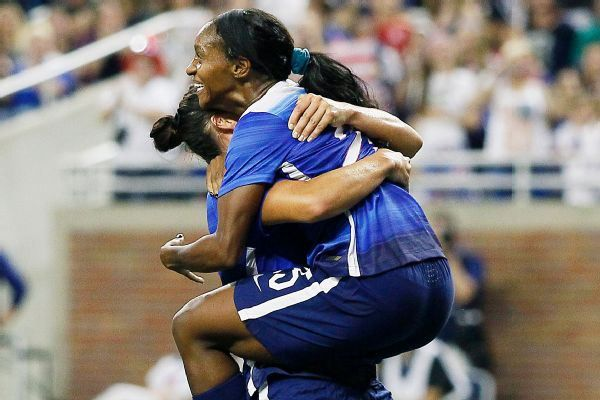 Crystal Dunn leaps into Ali Krieger's arms after her goal as time ran out against Haiti. (Duane Burleson/Getty Images)