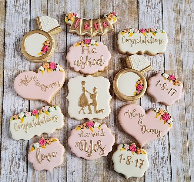 Congratulations Arlene and Danny on your engagement! He asked and she said YES! #decoratedcookies #sugarcookies #sugarart #customcookies #cookiesofinstagram #instacookies #edibleart #royalicing #nycbaker #nyccookies #engagementcookies #engagement #nycevents #nyceventplanner #weddingcakes Cookie cutters by @trulymadplastics @thesweetdesignsshoppe @whiskedawaycutters gold highlighter by @cakesbyangelamorrison