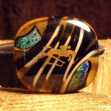 Trophy Maker PONY TAIL HOLDER This unique design in blacks, whites, yellows and dynamic dichroic hues, accented with a 22k gold leaf jumper horse design. Includes mounted damage-free hair scrunchy. $ 10.00