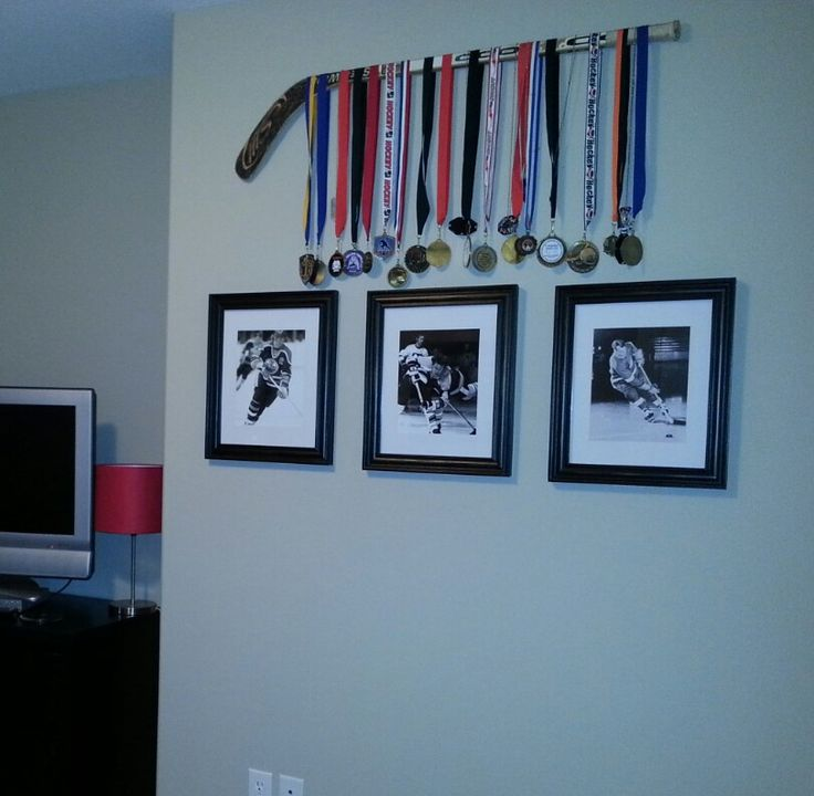 Boys hockey room. Great way to  display all of his medals! I did this in my sons room and love how it turned out! You could even use his first hockey stick!