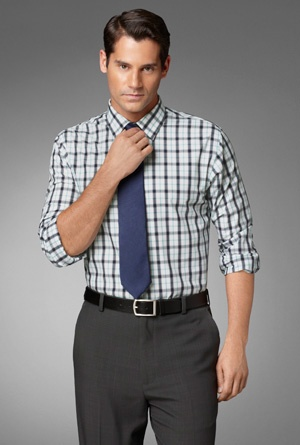 From our Studio Collection. Slim fit broadcloth button-down in a fashionable plaid print. With point collar and French placket.