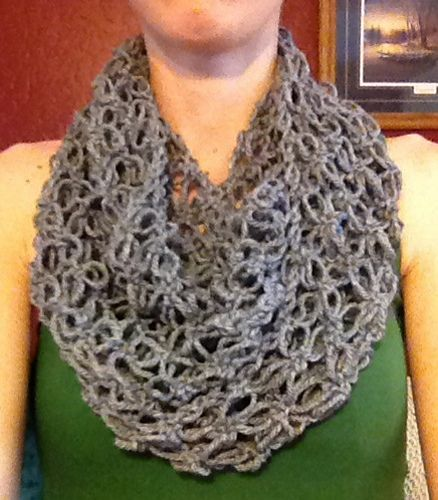This infinity/mobius scarf is beautifully lacy thanks to the open stitches of…