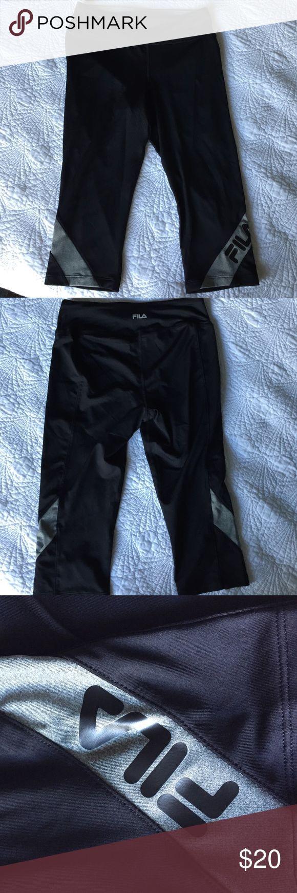 FILA Black and Gray Athletic Pants, Size Small FILA Black and Gray Athletic Pants, Size Small. 88% Polyester, 12% Spandex. Like new. Fila Pants