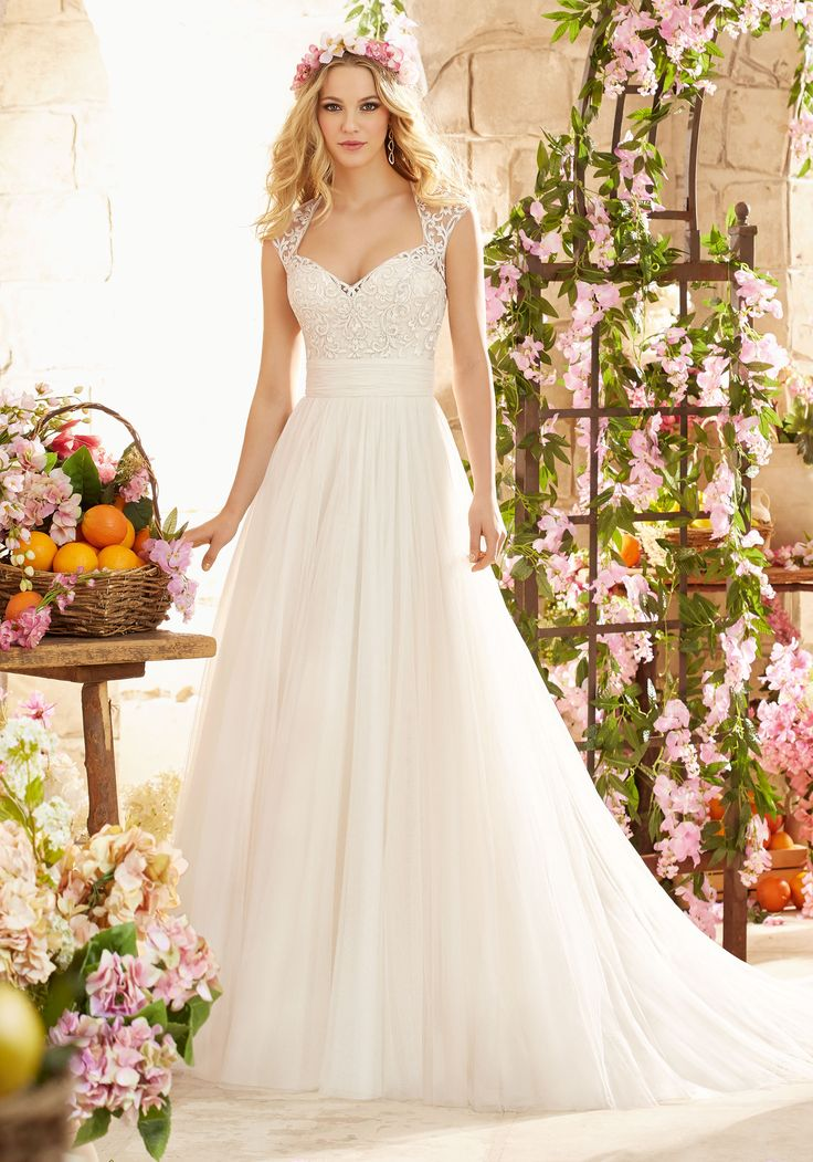 Majestic Wedding Dress with Embroidery on Soft Net Designed by Madeline Gardner. Colors available: White and Ivory, and Champagne.