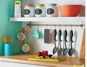 Bright Colours in the Kitchen. Utensils bar is a good idea.