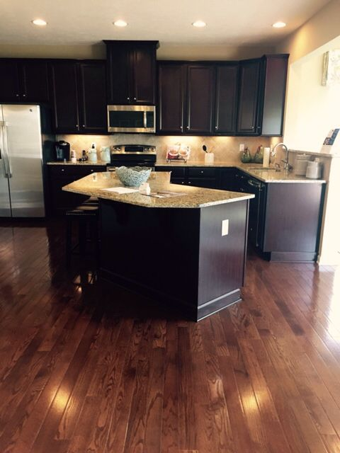 "Ryan Homes espresso cabinets and saddle 3 1/4"" hardwood floors"