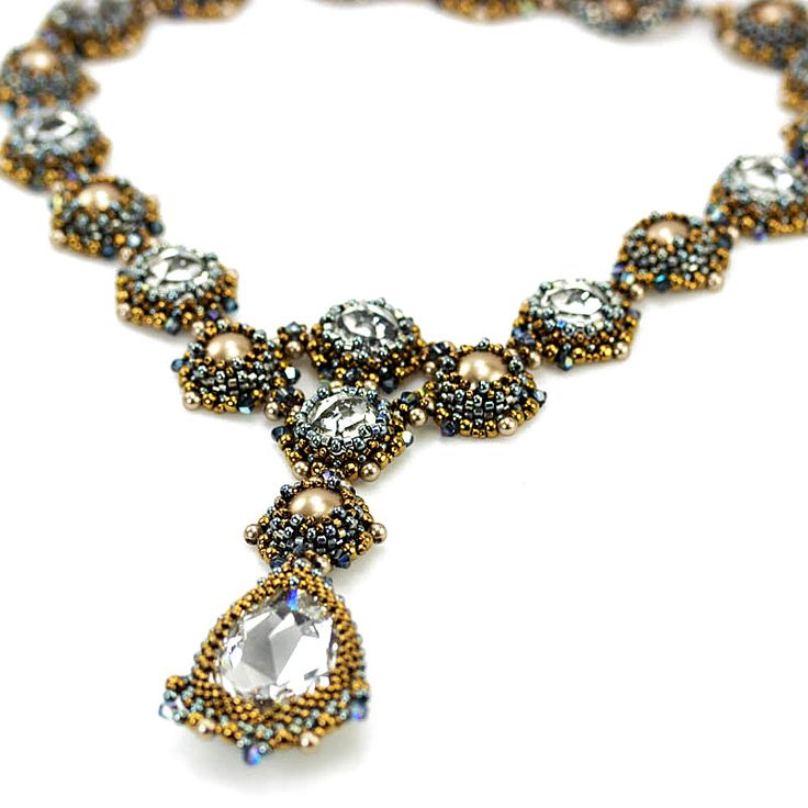 This elegant necklace features Swarovski dome shaped, flat back crystals, and a Swarovski tear drop shaped center piece. Create a variety of components using circular and flat peyote. The kit includes