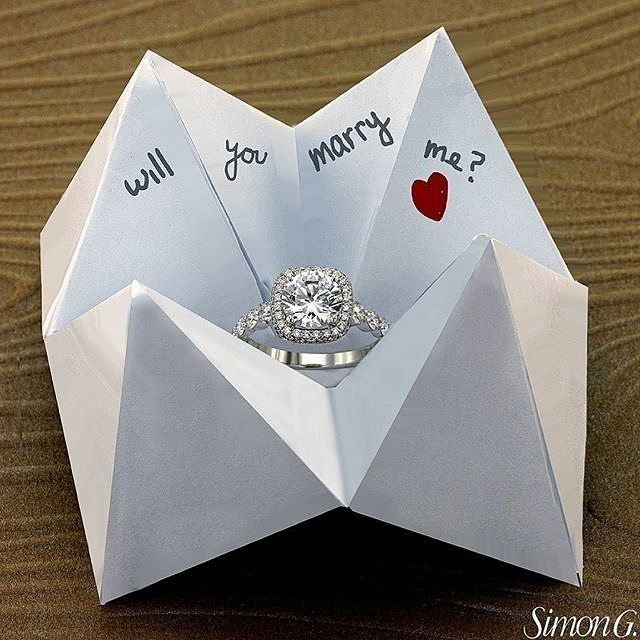 Old school meets new school! Isn't this @simongjewelry proposal just adorable!? #engagementring