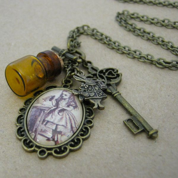 Alice In Wonderland - Potion Charm Necklace.  Through the Looking Glass and Down the Rabbit Hole.  Drink Me.  Available in my madeit store www.madeit.com.au/OnAWhimDesigns