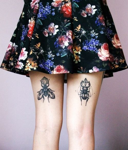 Insect tattoos on the thigh