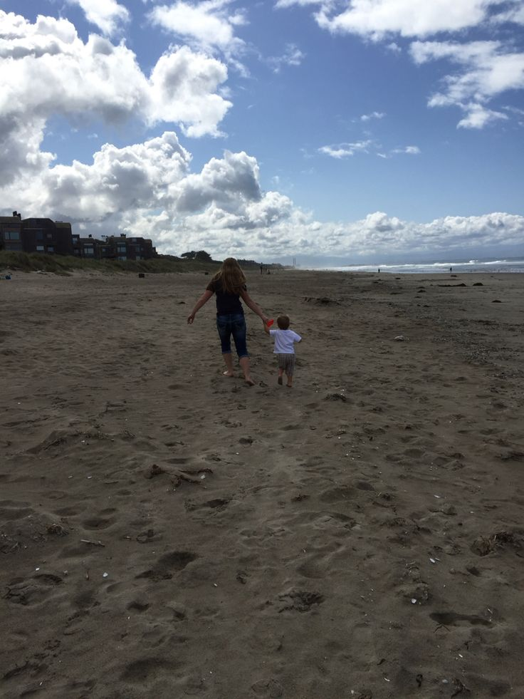 my two-year-old cousin henry and i running around on the beach of monterey bay, california.