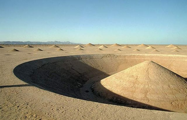 """Created by Greek artist Danae Stratou and the DAST art team in the mid-1990s, this earthwork art is called """"Desert Breath."""" It covers 100,000 square meters in the Egyptian desert near the Red Sea, and took several years to create. At its center was a fairly deep pool of water, and the whole project was designed to slowly erode over time. Which is exactly what's happened"""