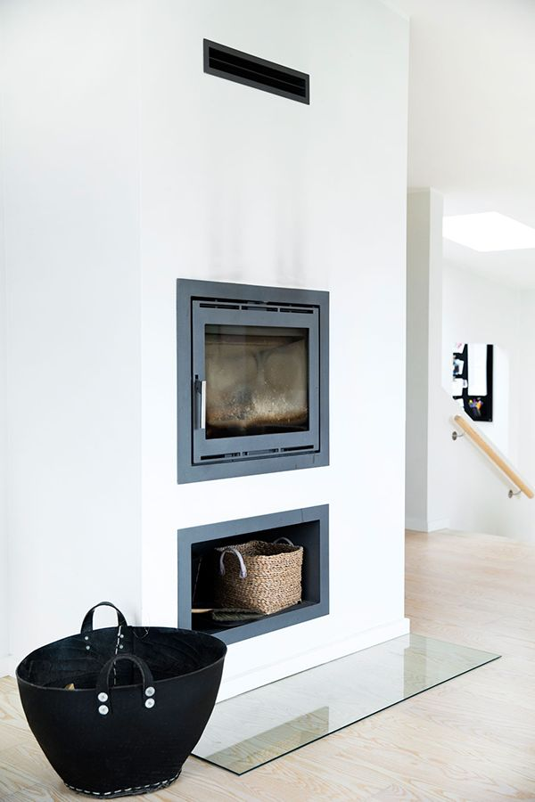 way to raise fire box up, put wood storage underneath and glass hearth over hardwood to fireproof it