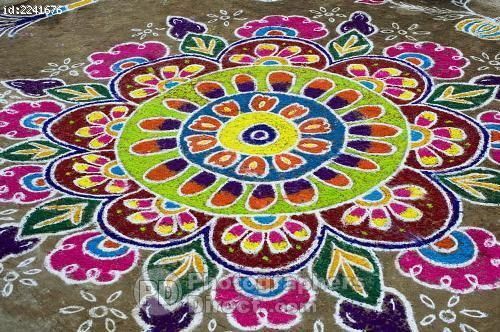 rangoli floral design in an indian street stock photo