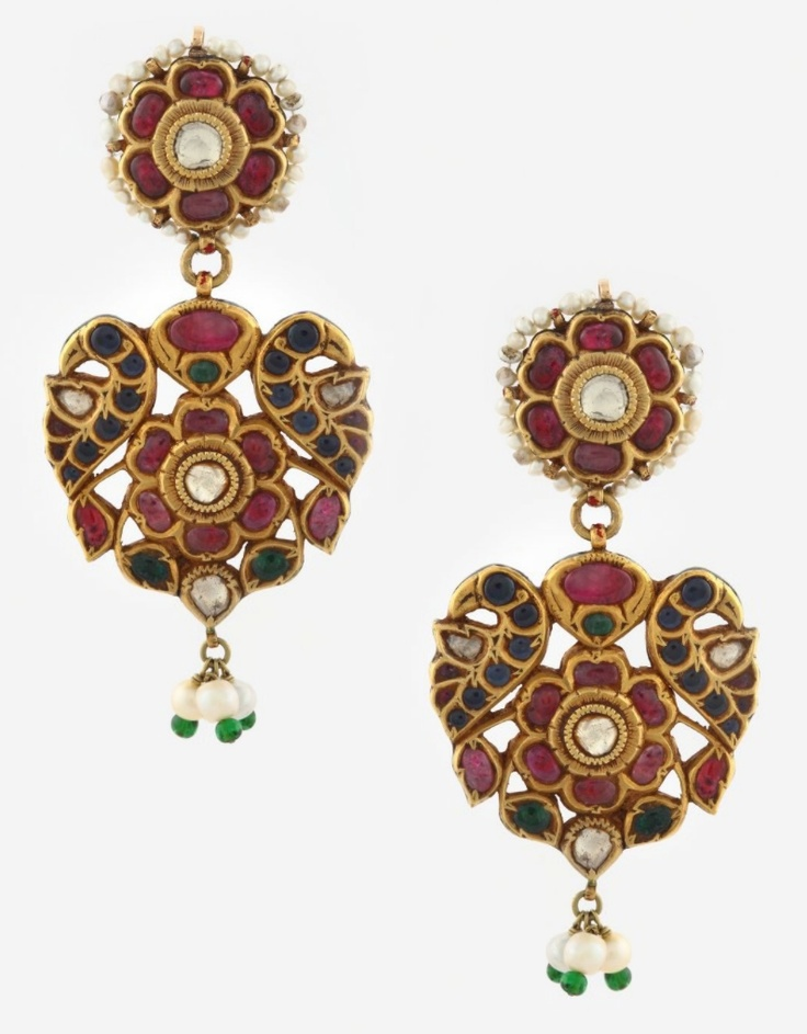 A MAGNIFICENT PAIR OF RUBY AND EMERALD 'PARROT' EAR PENDANTS Each designed as a stylized flower-head, flanked by a pair of parrots, set with table-cut 'polki' diamonds, rubies and emeralds, to a surmount of flower-head design. The emeralds and rubies weight approximately to 20.50 carats in total, and the diamonds weighs approximately 1.90 carats. The reverse is decorated in polychrome enamel on a white ground.