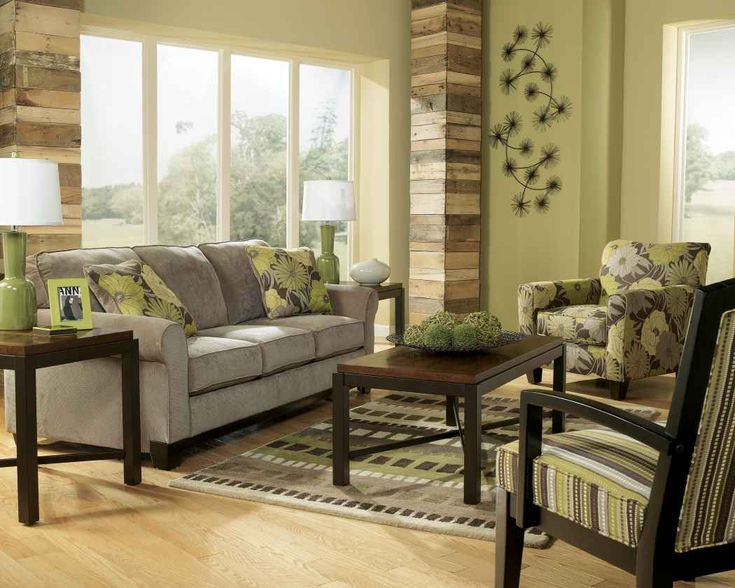 Earth tone living room with green wall paint and gray sofa for Living room paint ideas with grey furniture