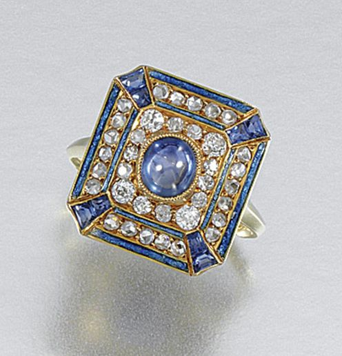 ENAMEL, SAPPHIRE AND DIAMOND RING, G. FOUQUET, EARLY 20TH CENTURY.  Of plaque design, centring on a millegrain-set cabochon sapphire within a surround of circular- and rose-cut diamonds and calibré-cut sapphires, within borders of blue enamel, size N, signed G.Fouquet, French assay marks and maker's marks, case by C.G.Hallberg, Stockholm.