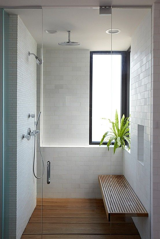 wood floor and wood bench in a shower