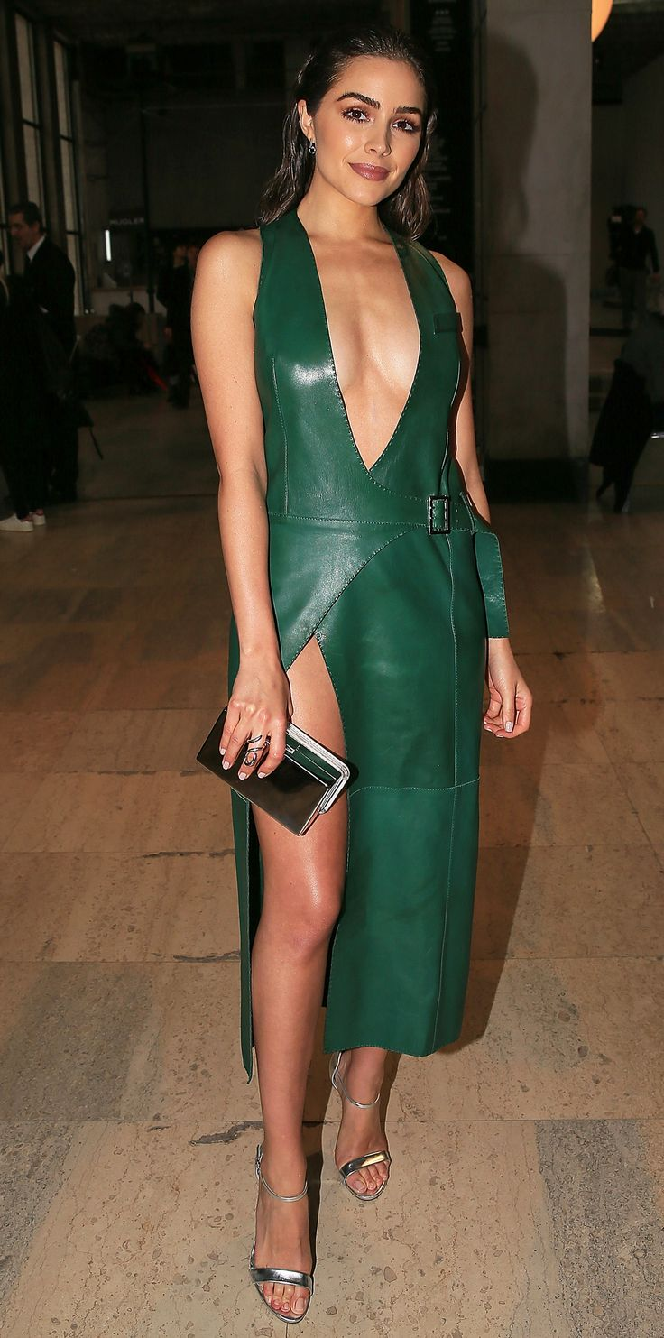 Olivia Culpo took the plunge at the Mugler show in this navel-gazing emerald leather dress featuring a higher-than-thigh-high slit and belt buckle closure. A metallic clutch, statement ring, and matching sandals kept the look fresh and modern.