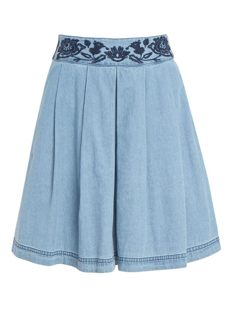 The Poppy Embroidered Chambray Skirt comes in a lightweight, blue cotton denim and features floral embroidery on the waistband.