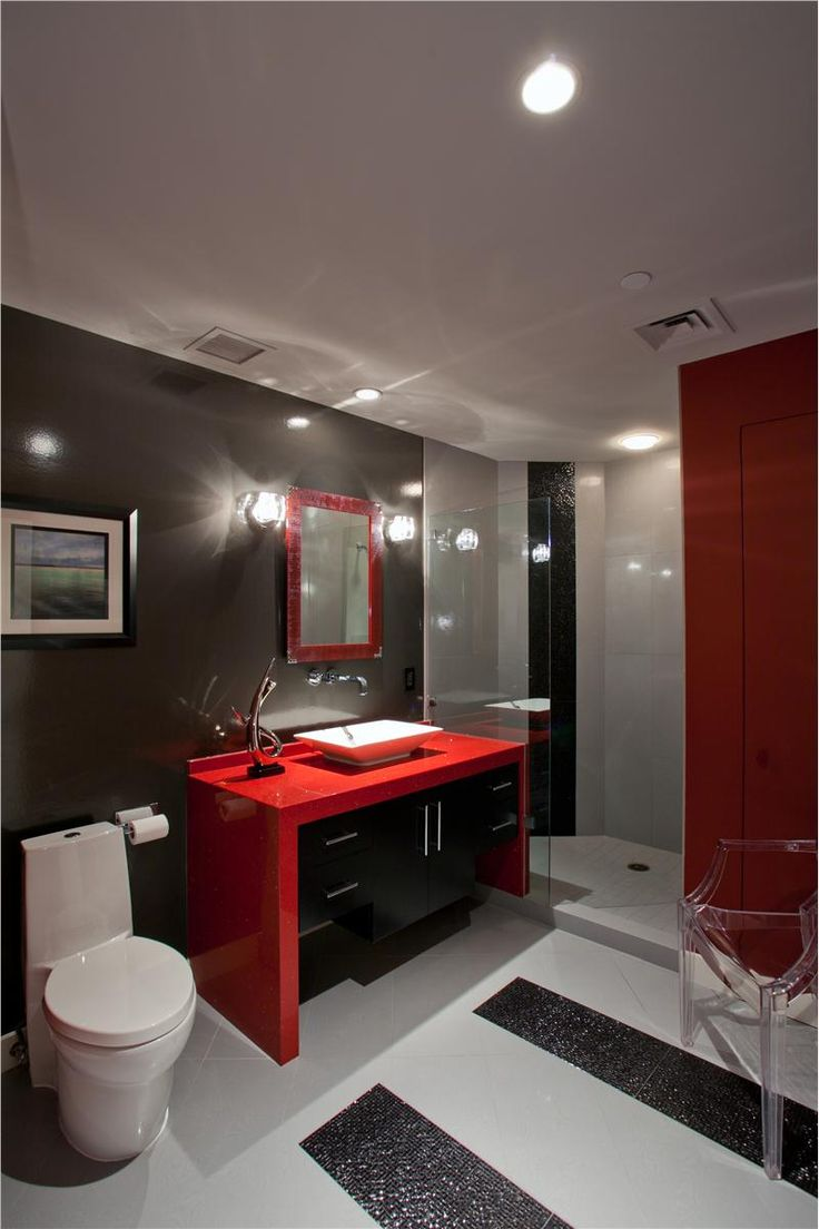 Bathroom - Modern bathroom with the drama of high fashion and yet a happy marriage of an adaptable colour palette.  The boldness of the vibrant red makes a fast statement....attitude!  Stunning!