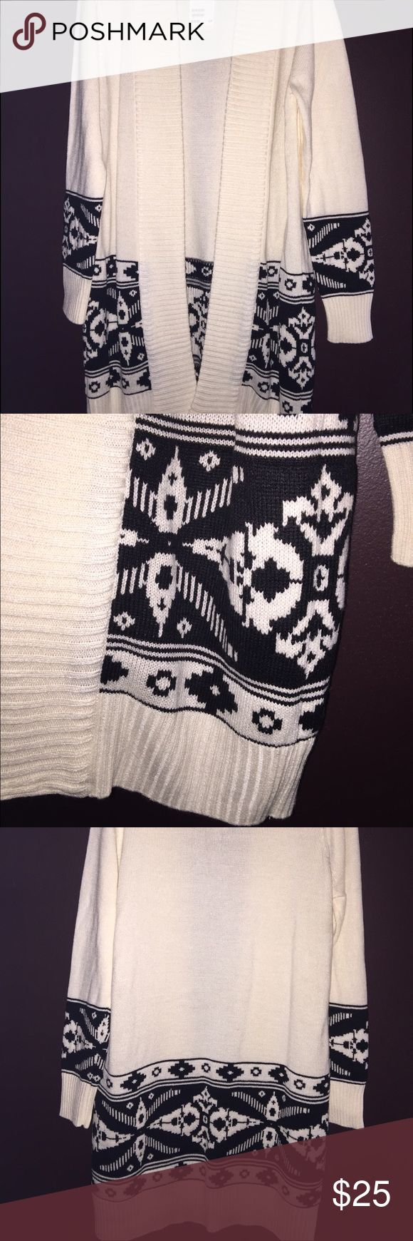 H&M Ladies long cardigan duster Size Large,  Ladies long cardigan with Fair isle details.  Creme and black.  Does not have buttoned or zippered closure,  it's meant to ne worn open.  I purchased to wear on Christmas but I've since lost weight and it's too large for me.  Never been worn,  tags still attached and still has fold lines. H&M Sweaters Cardigans