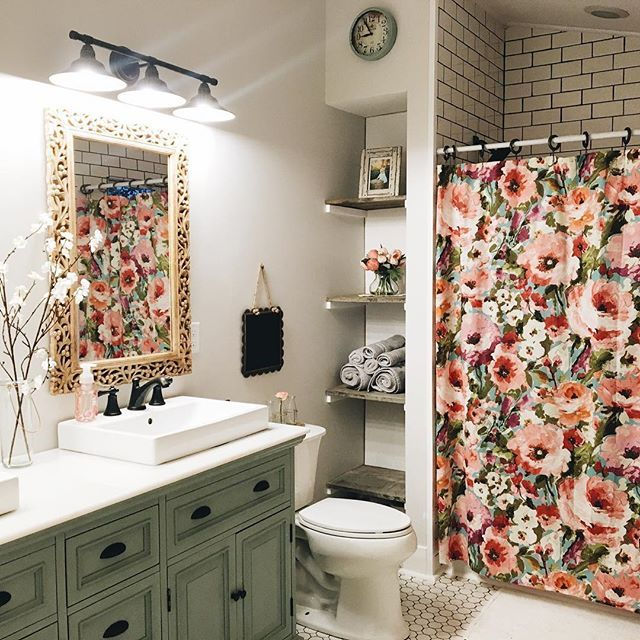 I love this bathroom! From the light fixture to the cabinet color, shower curtain, shelving, subway tiles and accessories! Little bit of farmhouse, industrial, etc