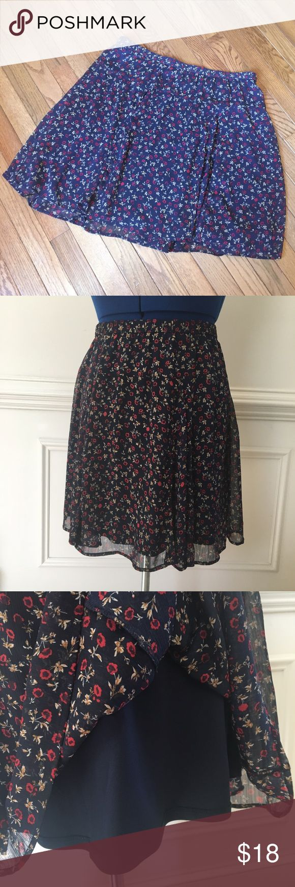 Navy Blue Floral Print Skirt, Old Navy, Large This skirt is frilly, floral, and feminine! Perfect skirt for spring, which is quickly approaching. Pair this with a solid colored blouse for a flirty look.  Red flowers set against a navy blue background.   Features an elastic band for a comfortable fit, and a navy blue lining.   Gently used, in excellent condition! Old Navy Skirts