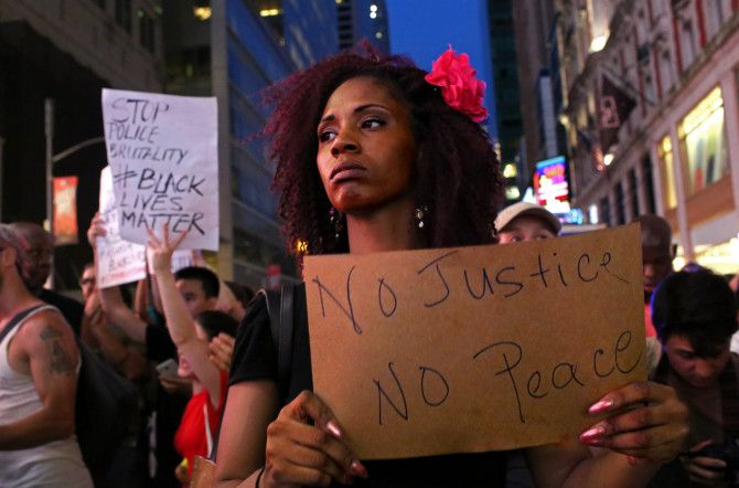 Activists protest in New York City's Times Square on July 7, 2016, in response to the recent fatal shootings of two black men by police.  Protests and public outcry have grown in the days following the deaths of Alton Sterling on July 5, 2016, in Baton Rouge, La., and Philando Castile on July 6, 2016, in Falcon Heights, Minn.