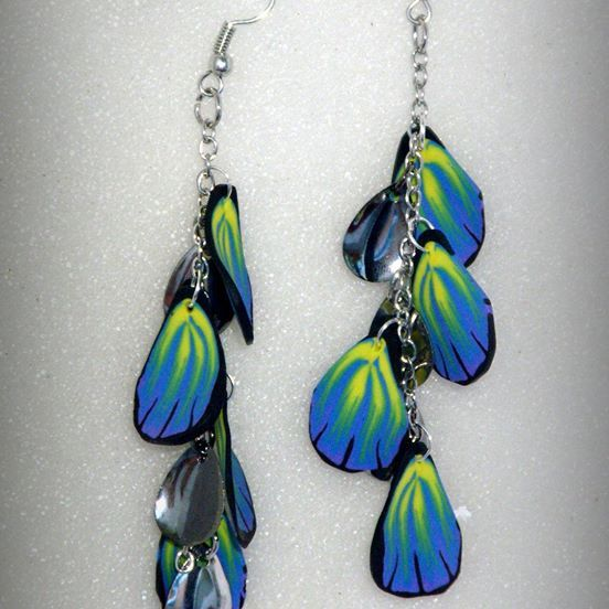 "Butterfly wing dangle/ cluster #Earrings. The earrings are handmade, one of a kind, lightweight and durable. Handmade, using slices of polymer clay Cane, hand-shaped into a ""butterfly wing""-like pattern. Supplemented with small oval silver hard-wear. This is a creative and unique piece of art, and will get the attention in any occasions. About 6 cm long with ear piece"