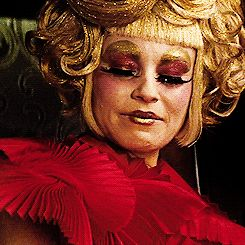 Pin for Later: 20 Things That Make Effie Trinket Effing Fabulous She Can Mimic an Oscar Statue