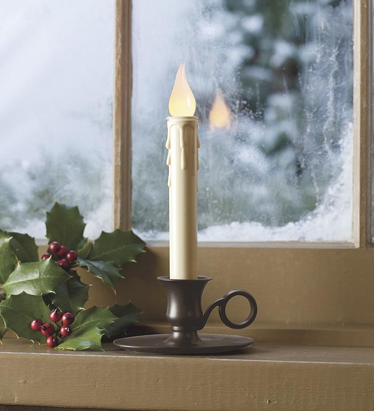 candle in window - welcoming | Christmas decor | Pinterest