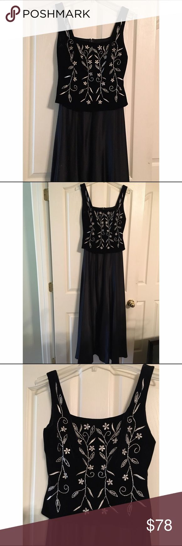 Long black and silver dress Long black and formal dress with silver design. It is one piece, the top is velvet, the bottom is satin. Dresses Wedding
