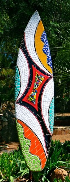 Cherrie La Porte has donated a mosaic glass surfboard with a 3D-fused stained glass surface. The board was damaged in the Indonesia surf and re-purposed into this amazing piece of art.