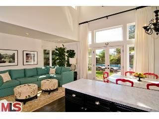 how about this couch in the kitchen? this is Tori Spelling's old house.