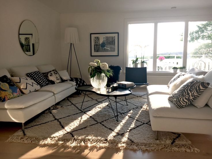 Ikea Söderhamn sofas, PK chairs, Swedese coffee table, Beni ourain rug, Flos ghost lamp