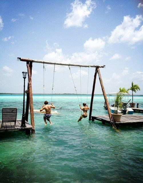 Possibly put a swing near a pond/lake. Hmm Swinging in Paradise Bacalar Lagoon -Mexico