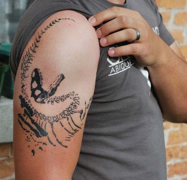 Tattoo: Allosaurus contorted into the classic dinosaur death pose
