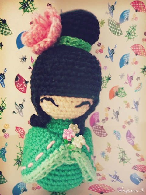Kokeshi. This one was made by me using this pattern: http://www.crochetville.com/community/topic/136826-amigurumi-kokeshi-dolls/