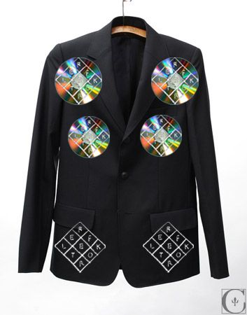 Reflektor Suit Jacket:  Plain Black Suit Jacket with a paper Reflektor logo pinned to the pockets.  The jacket also features 4 CD's with the Reflektor logo sharpied on them in either black or silver sharpie.  The 4 CD's will be pinned onto the jacket 2 on each side of the chest.