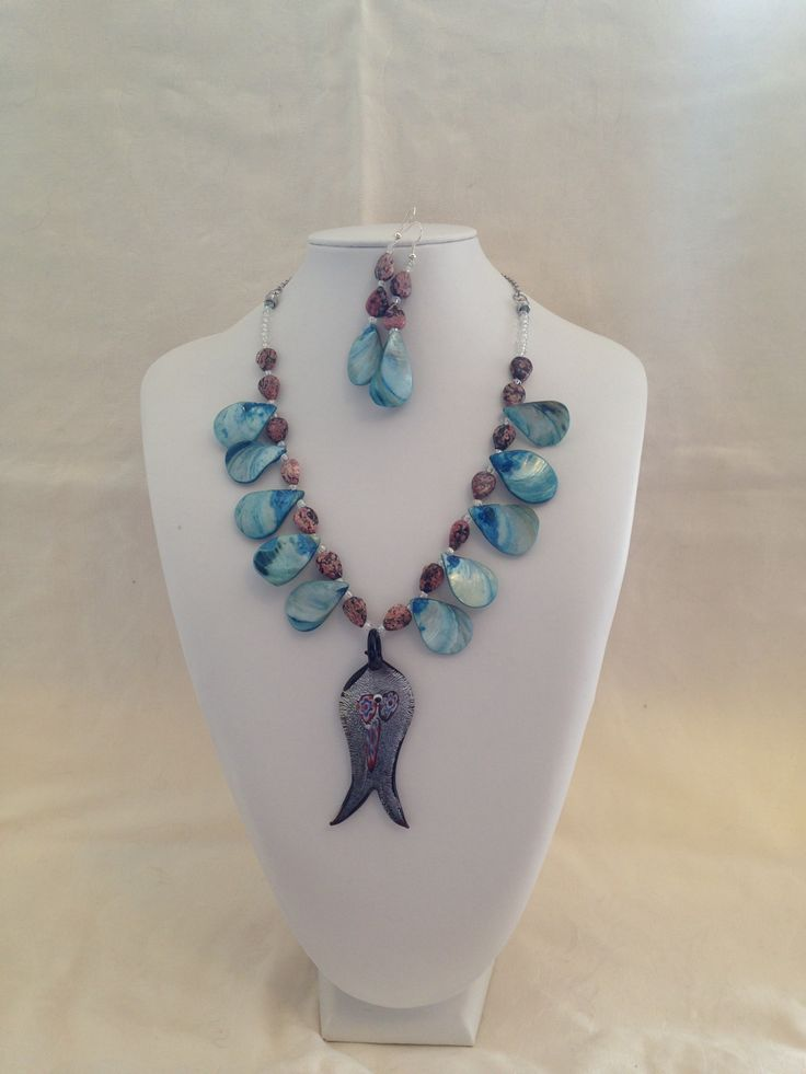 A bit silly, but fun necklace and earrings that reflects my sons huge interest in fishing. A glass fish pendant and blue shells. Fun!