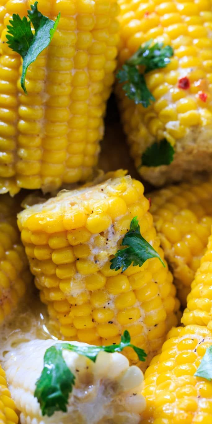 Crock Pot Corn on the Cob cooked with coconut milk and butter. ***Substitute whole milk