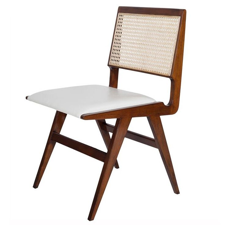 Cane back wood dining chair with white pu leather seat.