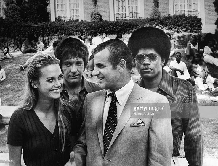 Peggy Lipton, Michael Cole, Tige Andrews and Clarence Williams III on a university campus for the television series, 'The Mod Squad,' c. 1968.