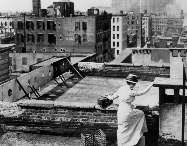 VNSNY nurse crossing the tenement rooftops circa 1900s