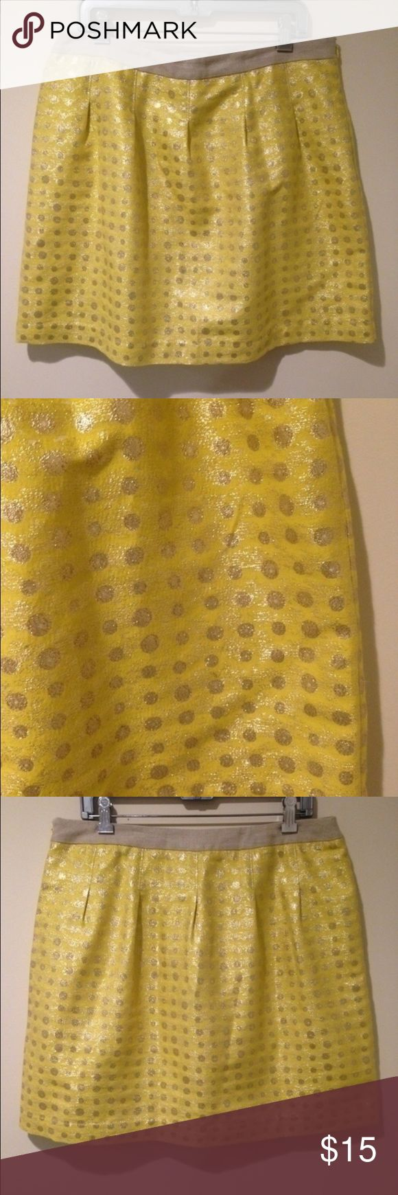 Loft Sparkly Lemonade Polkadot Skirt Add a pop of color to your skirt collection! Bright yellow featuring a light gold sparkle dust effect throughout. Shimmery metallic gold polkadots. Polyester lining, side zip closure. Exterior material is cotton, polyester and nylon. LOFT Skirts