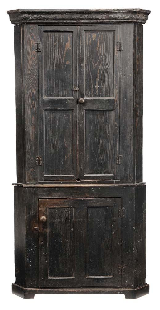 November 10-11, 2012 Southern Chippendale Paint-Decorated Corner Cupboard probably Georgia, late 18th/early 19th century, single-case construction, yellow pine throughout, two paneled upper doors and single double-panel door below, shelved interior, surface with probably original dark blue paint, original hinges, undisturbed backboards, 86-1/2 x 43-1/2 x 23 in., property from a Georgia Private Collection