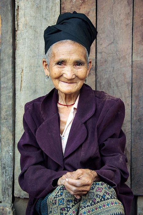 Lao Lady, having aged with grace with an endearing smile on her face.