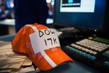 A trader's modified hat reads Dow 17K on the floor of the New York Stock Exchange during the morning of July 3, 2014 in New York City. The Dow Jones passed 17,000 for the first time today.