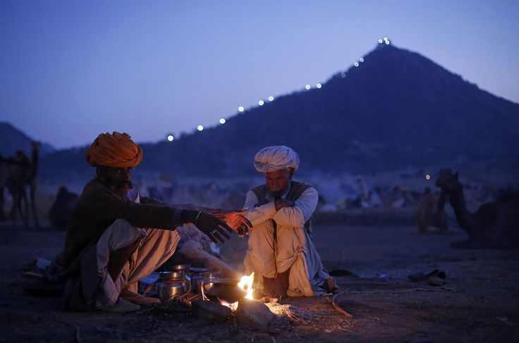 look at this site http://earth66.com/human/camel-herders-warm-india/